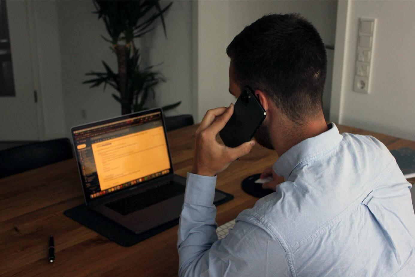man taking phone